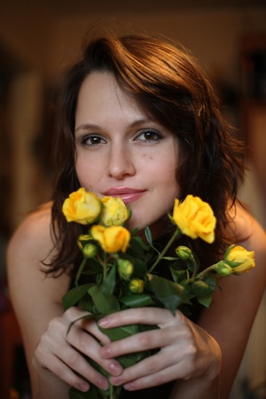 Portrait of the beautiful girl with a bouquet of yellow roses Stock Photo