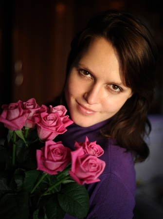 Portrait of the girl with a bouquet of pink roses