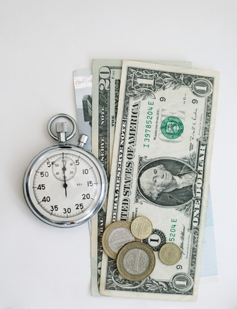 Watch and banknotes on a white background photo