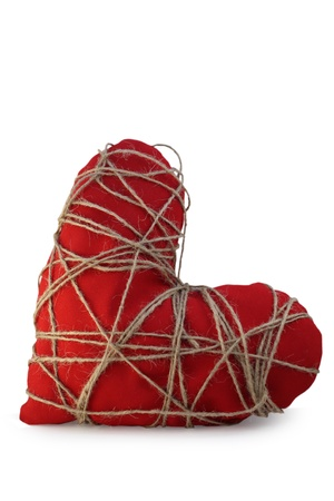 The red heart tied with a rope Stock Photo