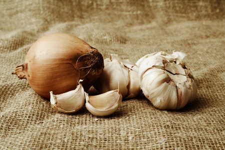 onions and garlic are on burlap Stock Photo