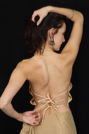 The girl with a naked back (on a black background)