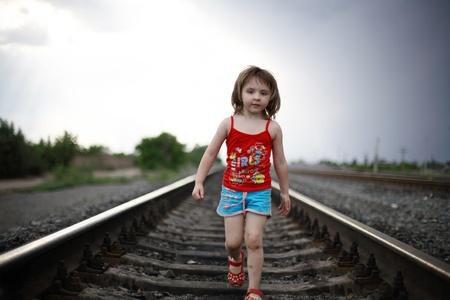 The little girl goes on rails