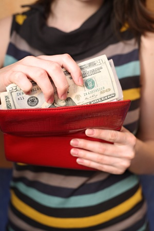 Female hands get money from a purse Stock Photo