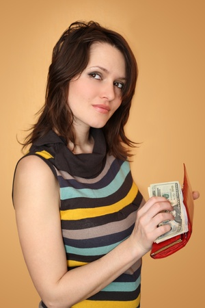 The girl holds a purse with money and dreams