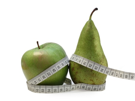 Photo of a green apple And pear wrapped up in tailors meter