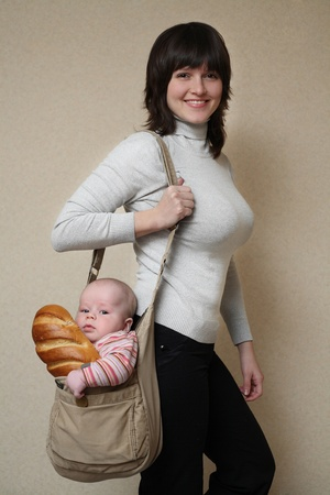 Mum with the son and a long loaf in a bag Stock Photo