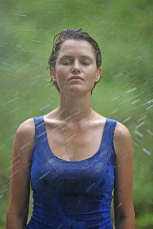 drops of rain fall on the woman photo