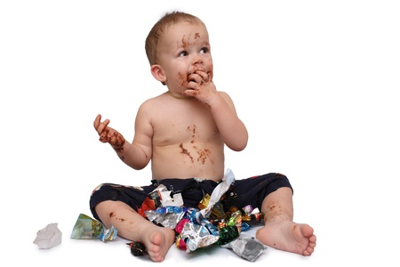 kid eats a lot of chocolate candies