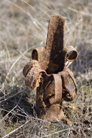 artillery shell: broken rusty shell casings from the Second World War
