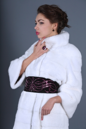 portrait of a girl in a white fur coat with decorations Stock Photo
