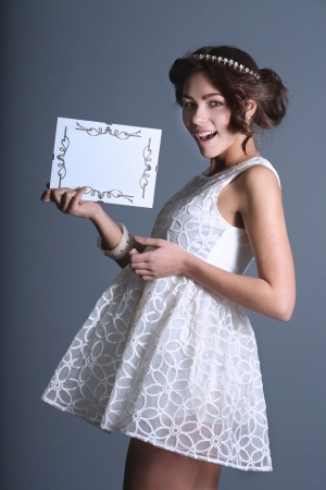girl in white with a beautiful sign in his hands