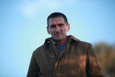 portrait of 50-year-old man in the sweatshirt