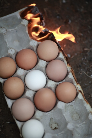time deficit: Burning box with chicken eggs, symbolizing the deficit