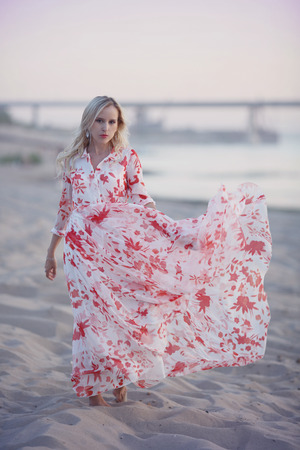 girl on the beach in developing long dress Stock Photo