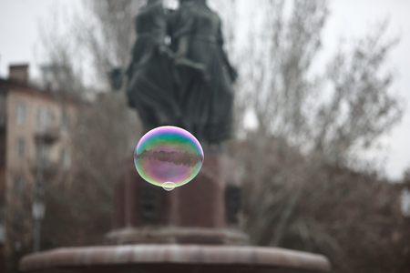 Rainbow bubble on the background of the town square Stock Photo