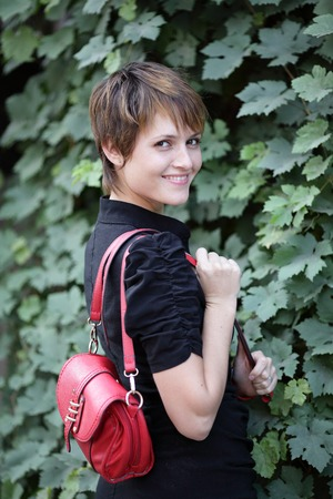 girl with red purse over her shoulder
