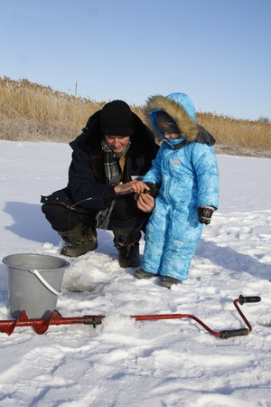4 year old: 4 year old boy on winter fishing with grandpa Stock Photo