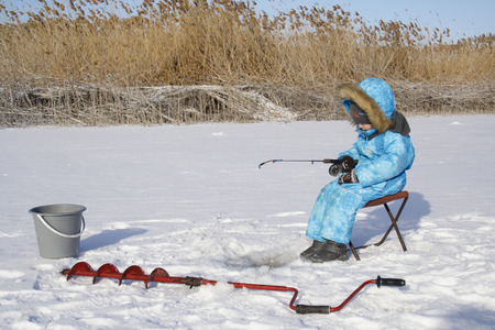 4 year old: 4 year old boy on winter fishing