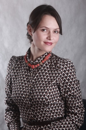 Portrait of a business woman with coral beads