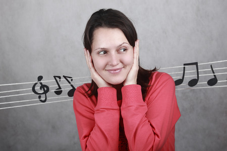 portrait of a smiling beautiful girl surrounded by notes Stock Photo