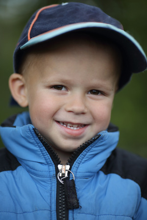 Portrait of a cheerful smiling boy in a cap