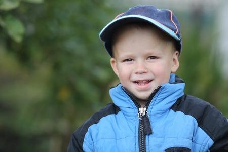 Portrait of a slyly little boy smiling Stock Photo
