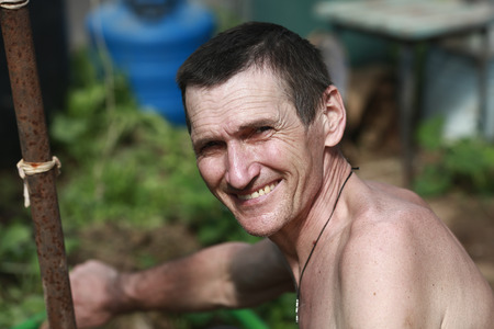portrait of a smiling 50 year old man