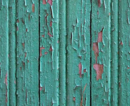 Old wooden background with cracked green paint. Texture with vertical clapboard boards Banque d'images
