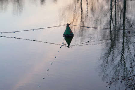 Divided water surface. Floating center intersection. Cables floats and determine sectorReflection surface creates the impression of spaciousness.