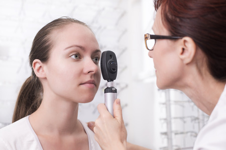 diopter: Beautiful young female patients at the optician Stock Photo