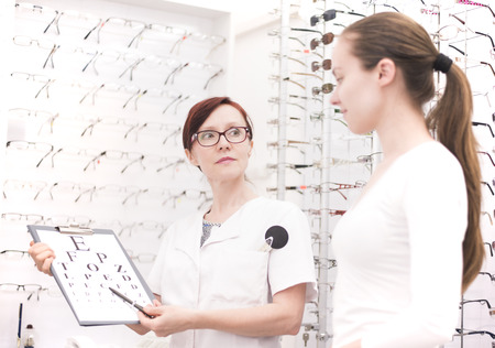 diopter: Young female patients at the optician Stock Photo