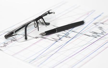 stock chart: Glasses on stock chart