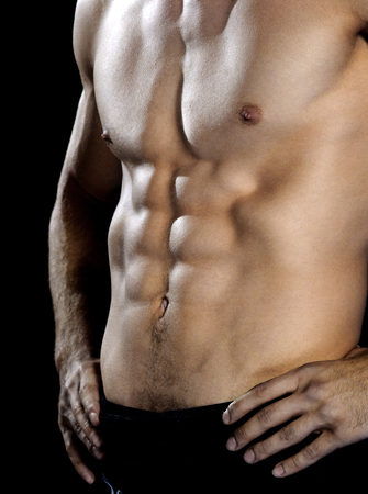 pectoral muscle: Muscular male torso on black
