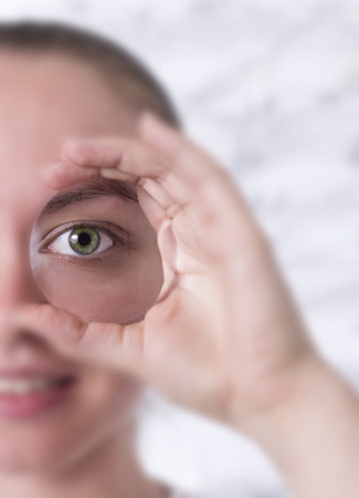optical instrument: Woman looking through a lens