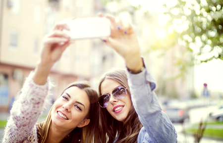 only teenage girls: Two girls making self portrait. Stock Photo