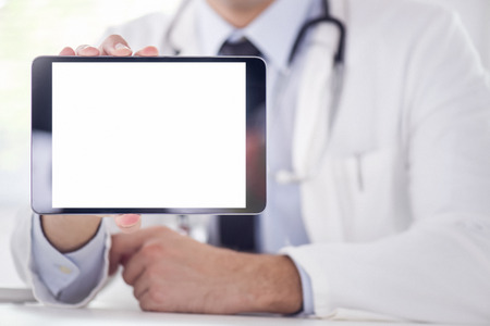 cropped shot: Cropped shot of a male doctor using a digital tablet. Stock Photo