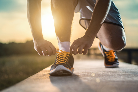 walk in the park: Man tying jogging shoes. Stock Photo