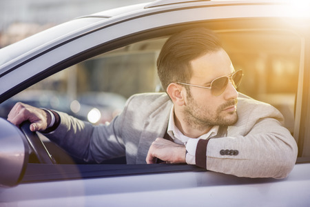 only man: Close up of a handsome man siting in his car.