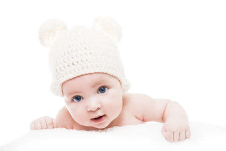 0 3 months: Baby wearing a knit hat with bear ears.