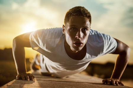 healthy sport: Young male jogger athlete training and doing workout outdoors in city.