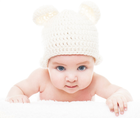 3 6 months: Baby wearing a knit hat with bear ears.