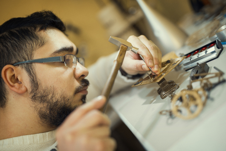 watchmaker: Watchmaker at work.Old pocket watch being repaired by watch maker. Stock Photo