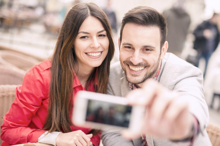 Cropped shot of an affectionate young couple taking a selfie Stock Photo