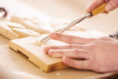 Carpenter at work.Wood engraving,close up.