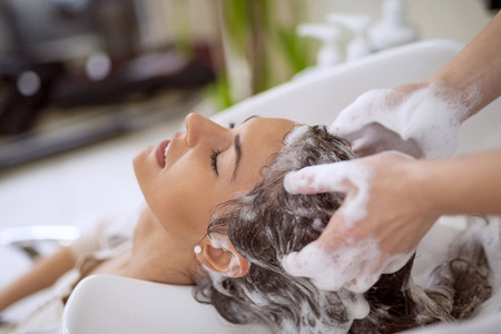 washing hair: Portrait of women which wash hair in a beauty salon.Hairdresser washing hair. Stock Photo
