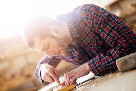 swarf: Carpenter at work.Wood engraving,close up.