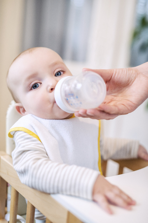 Close up of a baby boy drinking milk