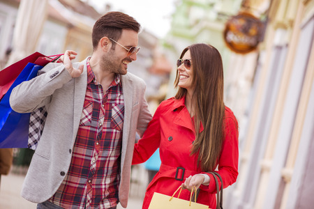 retail scene: Cheerful couple shopping together in the city. Stock Photo