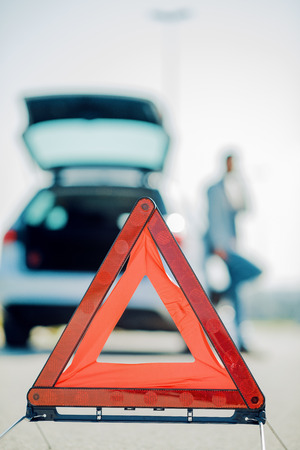 Car problems ,red warning triangle on road. Stock Photo